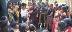 Tanvi Jain Patyal (in white) meets with a group during her work with her nonprofit, Parivartan.